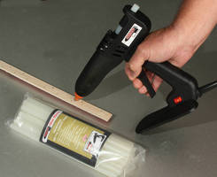 Professional Glue Gun accelerates tackstrip, trim installation.