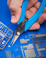 Precision Scissor cuts photo-etched parts.