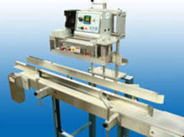 Vertical Conveyorized Band Sealer for handle pouches with zippers.