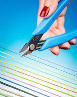 Ergonomic Scissor cleanly cuts difficult threads, cords, yarns.