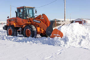 Snow Pusher Attachments mount to wheel loader buckets.