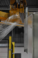 Seaming Device secures stretch wrap film tails.