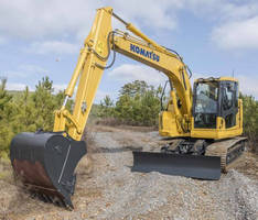 Hydraulic Excavator operates efficiently in confined spaces.