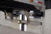 Recessed Vehicle Restraint secures trailers at dock.