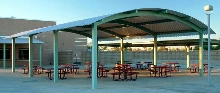 Steel Shelters are offered with custom-curved metal roofs.