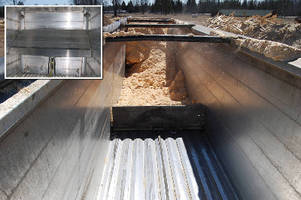 Plate helps offload non-flowing material from trailers.