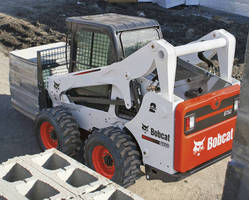 Skid-Steer Loader achieves maximum reach at full lift height.
