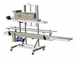 Heat Sealer and Conveyor handles large bag packaged products.