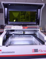 Laser Engraving Machine features 24 x 24 in. table.