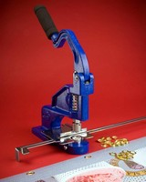 Hand Press features alignment fixture for spacing grommets.