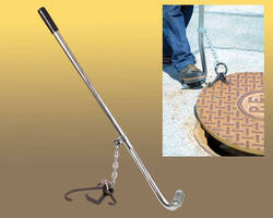 Utility Manhole Cover Lifter features rubber hand grips.