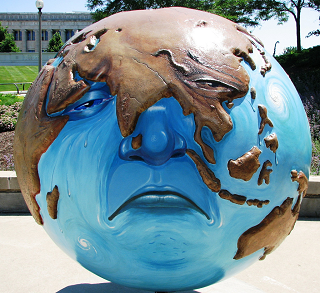 Photo of sculpture of a sad earth