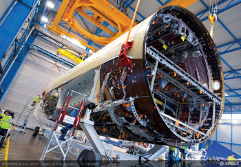 The fuselage of the Airbus A350 XWB is constructed more than 70 percent with composites, titanium and advanced aluminum alloys that produce a lighter aircraft. Credit: Airbus.