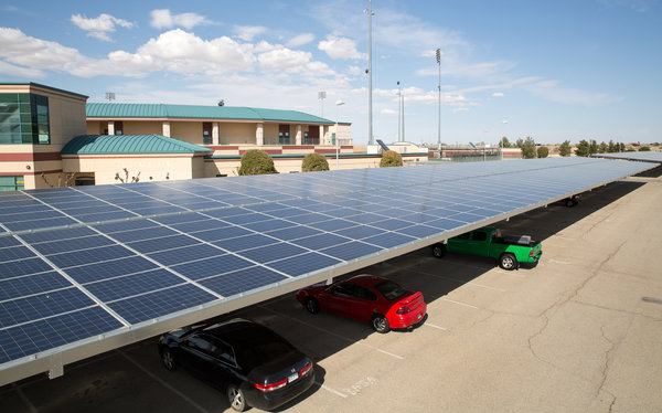 Solar panels on the roof of  a stadium parking lot in Lancaster, Calif. The city just became the first in the U.S. to require solar panels on all new homes. Credit: NYTimes.com