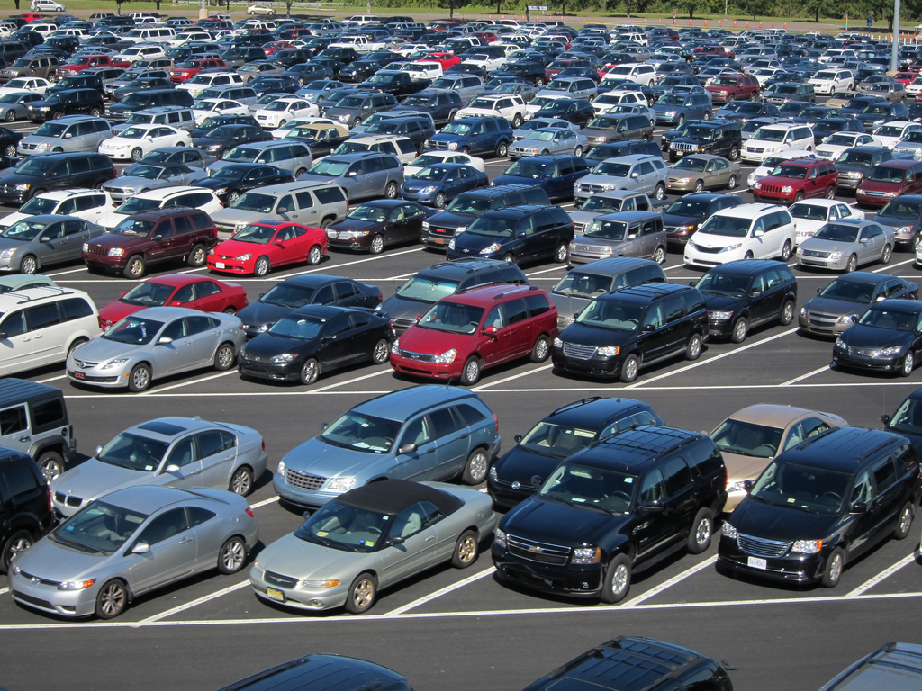 What is the carbon footprint of a full parking lot at a plant? Credit: Joe Shlabotnik.