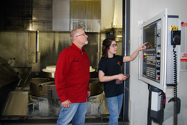 Pinch and Mid-Point Machine CEO John Halbach review a cutting program.