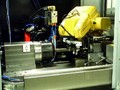 Thread Grinder features robot load/unload system.
