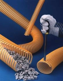 Urethane Hose transfers abrasive materials.