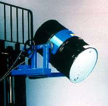 Forklift Attachment safely transports fully loaded drums.