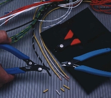 Wire Stripper Kit includes cutter, stripper, and slitter.