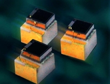 Photodiode monitors output of semiconductor lasers.