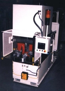 Loop Tunnel Parts Washer provides multi-stage cleaning.