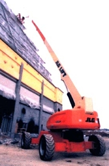 Boom Lift offers controlled arc work envelope.