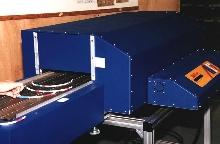 Controller varies conveyor speed of ovens.