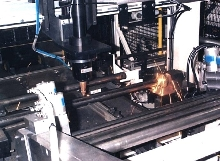 Laser System cuts cylindrical parts.