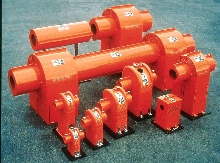 Protective Shields guard rotating couplings and shafts.