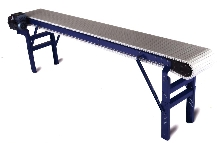 Conveyor utilizes acetal plastic chain for quiet operation.