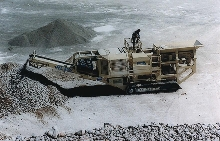 Track-Mounted Crusher goes to job site to crush stone.