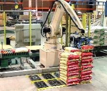 Automatic Palletizer stacks single columns.