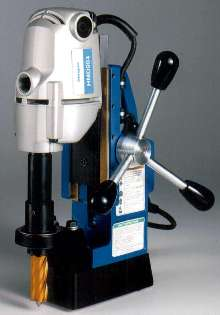 Portable Drill bores through tough alloys.