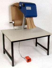 Packaging System manufactures paper cushioning on site.
