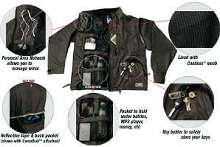 Sports Vest holds electronic devices and hydration systems.