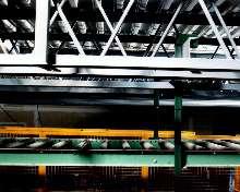 Conveyor Hanger System eliminates welding and bolting.