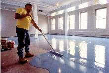 Floor Resurfacer covers spalled and damaged concrete floors.