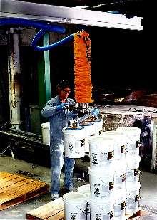 Vacuum Tube Lifter palletizes 5-gal pails.