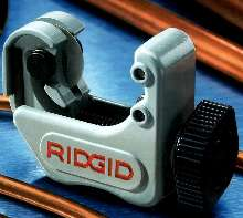 Tubing Cutter has spring-loaded cutter wheel.