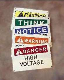 Safety Signs feature 3-color, 3-D engraved design.