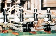Lubrication System applies oil to stock and dies.
