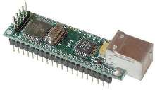 Microcontroller Board interfaces peripheral to computer.