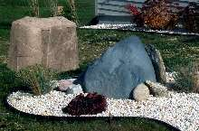 Landscape Rocks hide unsightly pipes and vents.