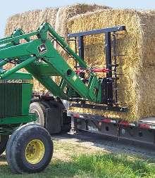 Bale Handler stacks large rectangular bales.