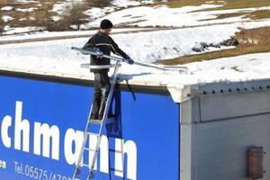 Adjustable Aluminum Ladder helps keep trucks clear of ice/snow.