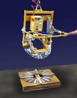 Vacuum Lifter-Tilter loads strip metal coil onto mandrel.