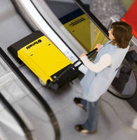 Escalator Cleaning System adjusts to different heights.