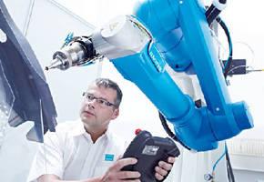 Laser Machine performs 3-dimensional metal cutting.