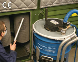 HEPA Vacuum attaches to 55 gallon open top drum.